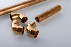 Copper fittings. And red pipe Stock Photo