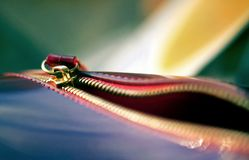 Copper gilt unzipped zipper on a leather bag with a blurred background. And bokeh stock photo