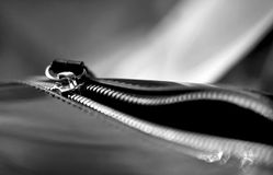 Copper gilt unzipped zipper on a leather bag with a blurred background and bokeh. Black and white stock images