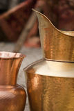 Copper golden metal vase and pan. Copper golden metal vase handcrafted pictured on display at a market Royalty Free Stock Photography