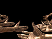 Copper Hands. Hands in Copper on the black background Royalty Free Stock Photo