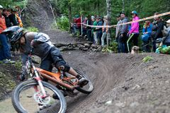 On 9/2/2017 in Copper Harbor, Michigan mountain biker cornering fast in the berm during enduro race royalty free stock photography