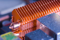 Copper heat pipe with cooling fins. Copper heat pipe with dissipating fins on computer motherboard stock photos