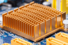 Copper heat sink on computer motherboard. Copper heat sink  on computer motherboard abstract background Stock Image