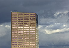 Copper High Rise Building On Cloudy Day Stock Photos