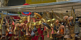 Copper horns and lanterns for sale on the flea market Royalty Free Stock Image