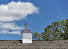 Copper horse on rooftop weathervane Royalty Free Stock Photo