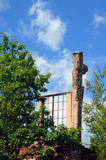 Copper Industry Ruins. The Quincy Mill flotation building stands in ruins and overgrown with weeds and bushes. This building is a remnant of the copper mining stock photography