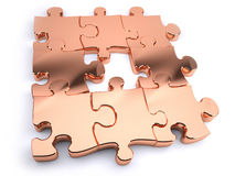 Copper jigsaw. With piece missing Royalty Free Stock Photos