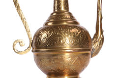 Copper jug with a traditional Arabic ornaments on a white background Stock Photography