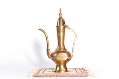 Copper jug with a traditional Arabic ornaments on a white background Stock Image