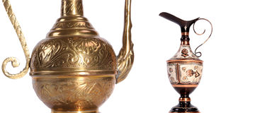 Copper jug with a traditional Arabic ornaments on a white background Royalty Free Stock Photos
