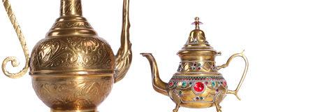 Copper jug with a traditional Arabic ornaments on a white background Stock Photo