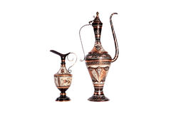 Copper jug with a traditional Arabic ornaments on a white background Stock Photos
