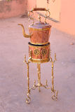 Copper kettle and burner on sale in the street. Morocco Royalty Free Stock Photos