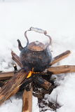 Copper kettle over an open fire in winter Stock Photos