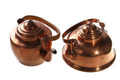 Copper kettles. Antique copper kettles. over white Royalty Free Stock Photography