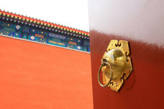 The copper knocker on red door in the Zhengjue temple in Old sum Stock Images