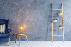 Copper lamp and side table Royalty Free Stock Images