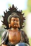 Copper like mini sculpture of Buddha Stock Image