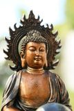 Copper like mini sculpture of Buddha Royalty Free Stock Photography