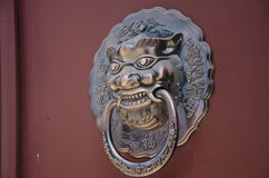 The copper lion. Lions Gate copper China ancient architecture in hand Royalty Free Stock Photos