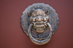 The copper lion. Lions Gate copper China ancient architecture in hand Stock Photos