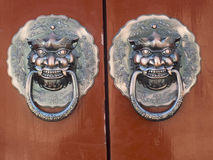 The copper lion. Lions Gate copper China ancient architecture in hand Royalty Free Stock Image