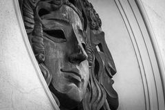 Copper mask on building Stock Images