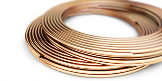 Copper metal pipes goods on white background. Stock Photography