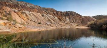 Copper mine near Tsar Asen Village. Artificial lake near abandoned copper mine royalty free stock photo