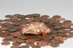 Copper Nugget on a Bed of Pennies Royalty Free Stock Photography