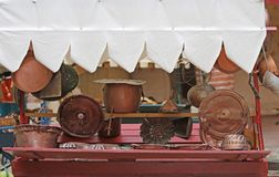 Copper objects for kitchen and home for sale at flea market Royalty Free Stock Photo