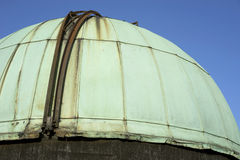 1890 copper observatory dome. This aged and verdigris copper dome houses a wooden Newtonian telescope built in 1890 in Stirling, Scotland stock image
