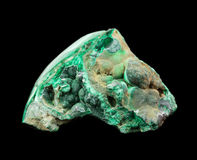 Copper ore malachite. Collection mineral specimen of green malachite, copper ore, isolated on a black background stock photos