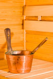 Copper pail. And dipper in finnish sauna, vertical format Stock Images