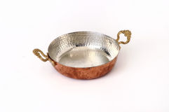 Copper pan. Traditional copper pan isolated at white background Stock Image