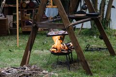 Copper pan on fire with chicken during a Middle Ages historic re. Enactment royalty free stock images