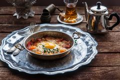 Copper pan with fried eggs and sausages, turkish style Royalty Free Stock Images