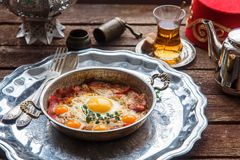 Copper pan with fried eggs and sausages, turkish style Stock Images