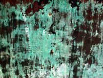 Copper Patina. Green tarnish on a copper and bronze surface Royalty Free Stock Image