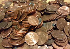 Copper Pennies, American Money, Spare Change, One Cent Coins. Hundreds of pennies wait to be sorted, counted, and rolled Stock Photo