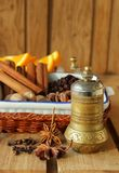 Copper pepper mill and spices for cooking Royalty Free Stock Image