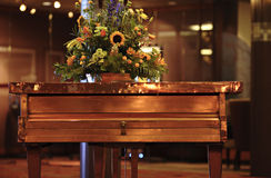 Copper piano. With flowers on top Royalty Free Stock Photos