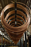 Copper pipe factory. Stacked copper spiral parts royalty free stock photo