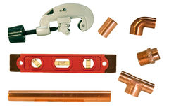 Copper pipe fittings and cutter Royalty Free Stock Photo