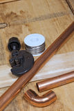 Copper pipe and plumbing supplies. Copper pipe and typical plumbing supplies royalty free stock images