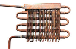 Copper pipe and radiator of old direct flow water heater, isolat Stock Photography