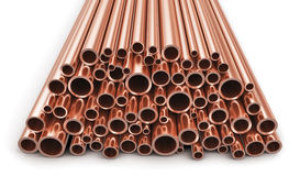 Copper pipes. Creative abstract heavy non-ferrous metallurgical industry and industrial manufacturing business production concept: heap of shiny metal copper Royalty Free Stock Photo