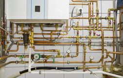 Copper pipes engineering in boiler-room Stock Images